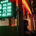 Курс доллара впервые за полтора года упал ниже 60 рублей